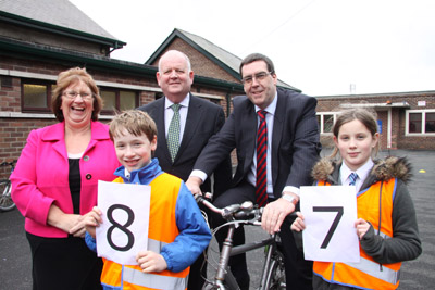 Members of the Assembly's Regional Development Committee get on their bikes at Gilnahirk Primary School