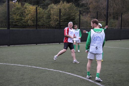Jonathan Bell MLA checks if his strike is a winner at the recent MLA football match against 'World United' to promote the IFAs Football Against Racism Europe campaign.