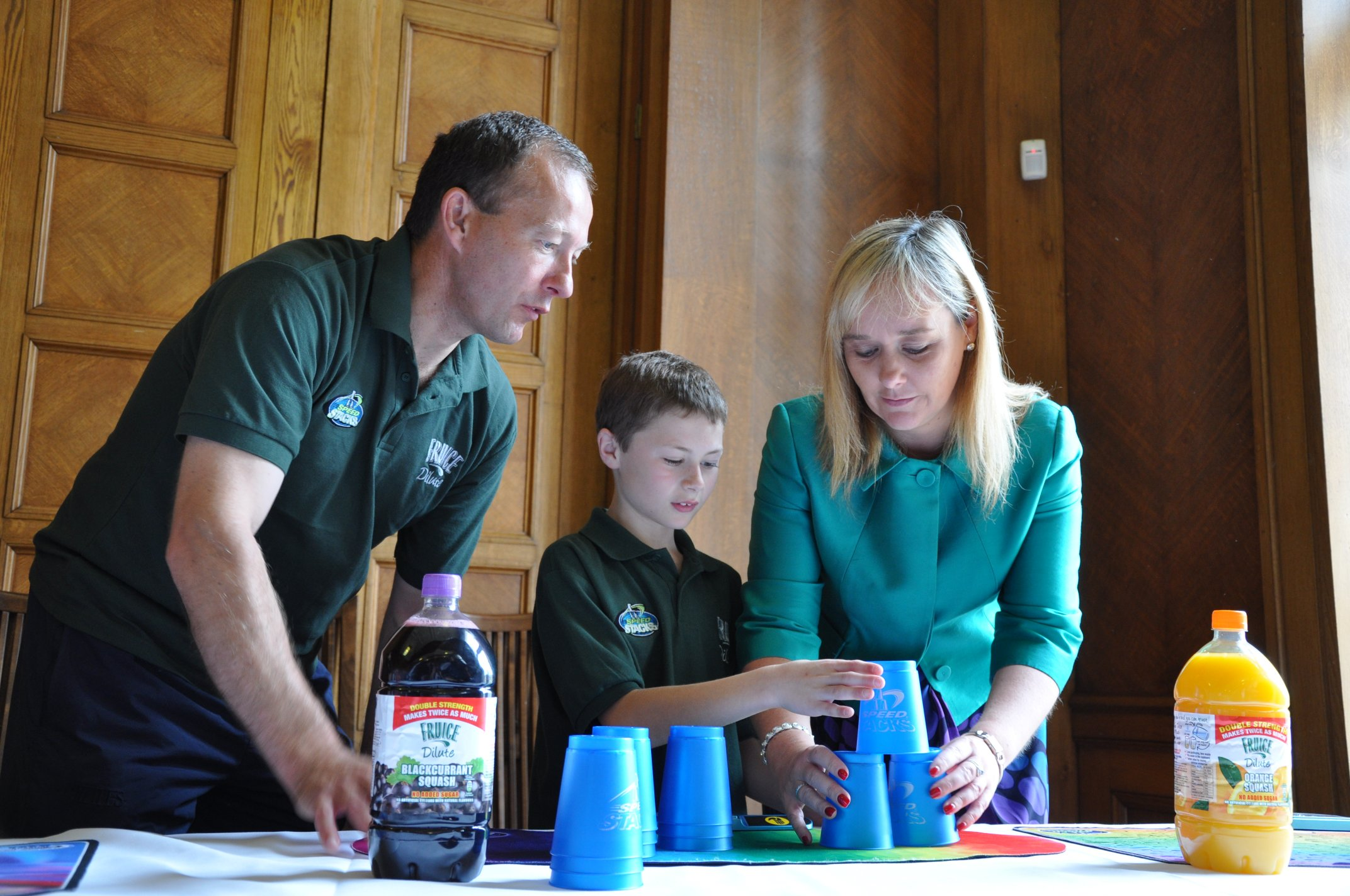 Coach of the Irish Sport Stacking Team, Micheal Nolan is pictured giving some tips on the sport to Michelle McIlveen MLA, Chairperson of the Culture, Arts and Leisure Committee.