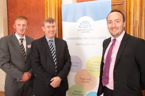 Chairperson of the Education Committee, Mervyn Storey MLA with guests at the Committee's Area Planning event