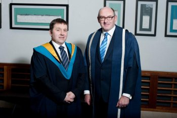 Chairperson of the Employment and Learning Committee, Robin Swann MLA with John D'Arcy, Director of the Open University at the Open University's Graduation in Belfast on 11 May 2013
