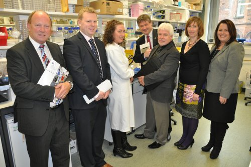 Members of the Northern Ireland Assembly Committee for Employment and Learning talk to a researcher on a visit to the Queen's University of Belfast's Centre for Cancer Research and Cell Biology. Pictured from left: Jim Allister, MLA; Alastair Ross, MLA; Chairperson of the Committee Basil McCrea MLA; Sammy Douglas MLA; Sandra Overend MLA and Michelle Gildernew MP MLA.