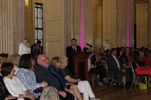 Mr Robin Swann MLA, Chairperson of the Committee for Employment and Learning welcoming attendees to the Belfast Metropolitan College fashion show in the Grand Hall, Parliament Buildings