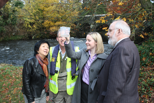 Committee members meet with representatives of the Northern Ireland Freshwater Taskforce to observe water quality at the Six Mile Water River in Antrim