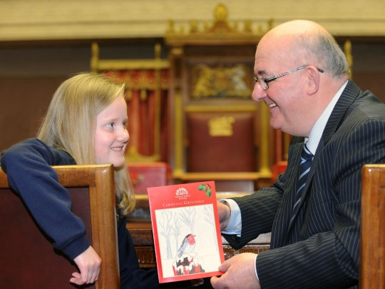 Speaker of the Northern Ireland Assembly, William Hay MLA with nine-year old Emma Isherwood from Edwards Primary School