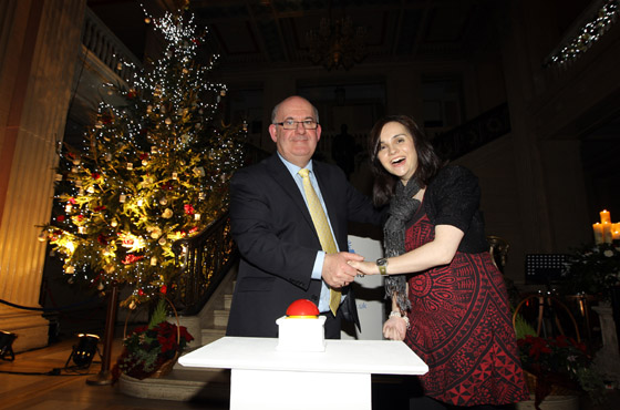 The Speaker of the Northern Ireland Assembly William Hay MLA, turns on the Christmas tree lights with the help of Cara McGerrigan.