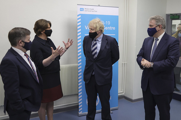 Boris Johnson at a Covid-19 vaccination centre on his visit to Northern Ireland, pictured with First Minister Arlene Foster, Health Minister Robin Swann, and Secretary of State for NI Brandon Lewis. | Source: Andrew Parsons / No 10 Downing Street
