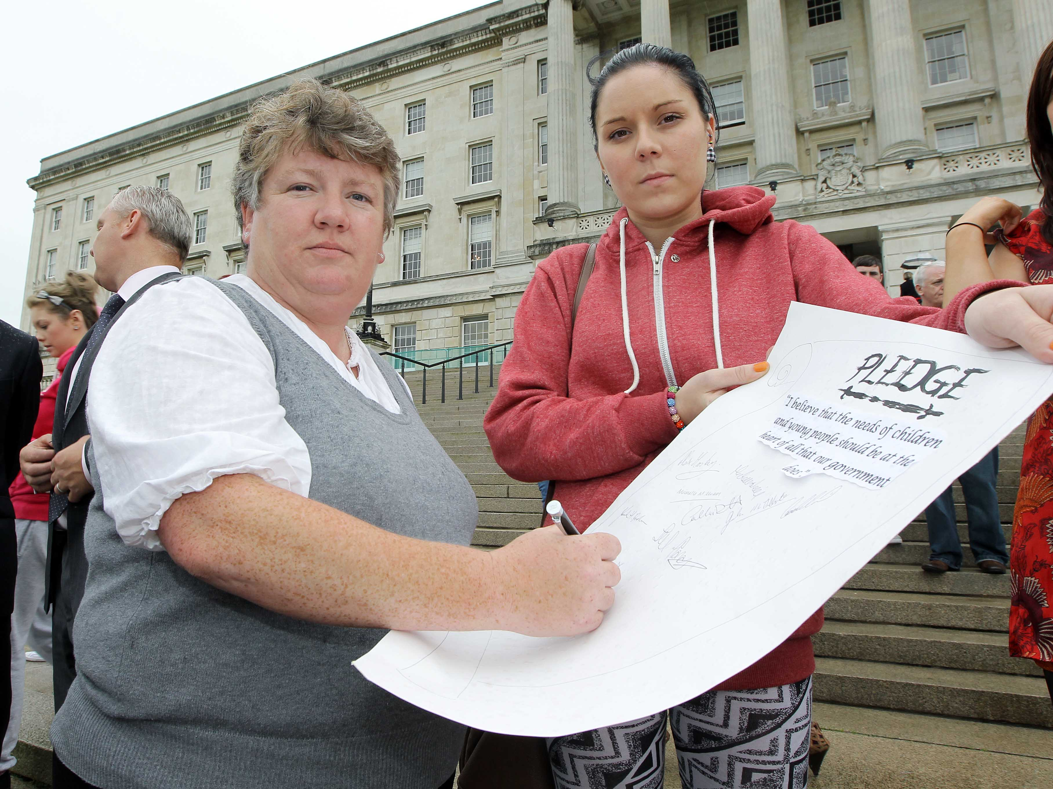The Chairperson of the Northern Ireland Assembly Health Committee Sue Ramsey MLA signs a pledge stating that the needs of children and young people should be at the heart of all that government does. The signing of the pledge followed a Health Committee led event where 80 young people met with MLAs and Ministers to mark World Suicide Prevention Day.