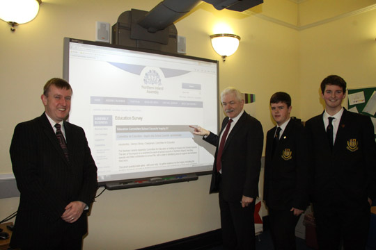 As part of the Northern Ireland Assembly Education Committee's Inquiry into School Councils, the Committee is asking school principals from Northern Ireland to complete a questionnairre. Committee Chair Mr. Mervyn Storey MLA is pictured launching the survey with the principal of the Boys' Model School, Mr Jim Keith and school pupils Jamie Lunn and Jonathon Dickey.