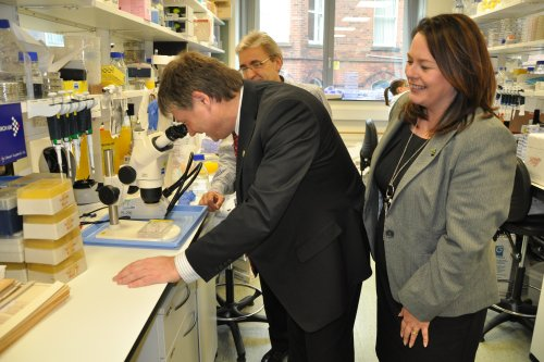 The Northern Ireland Assembly Committee for Employment and Learning on a visit to the Queen's University of Belfast's Centre for Cancer Research and Cell Biology. Pictured from left: Chairperson of the Committee, Basil McCrea MLA; Director of the Centre, Professor Dennis McCance and Committee member Michelle Gildernew MP MLA.