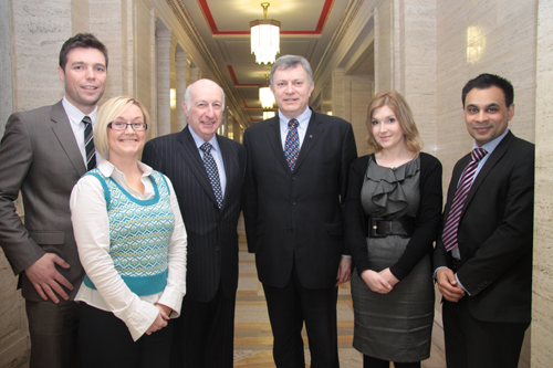 ETI Committee Chair Patsy McGlone and Robin Newton pictured with sector representatives on payday lending