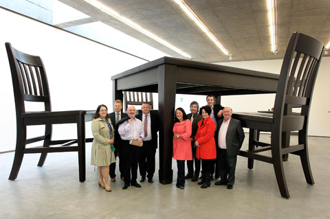 The Assembly Committee for Social Development visited the Cathedral Quarter today (Thursday 3rd) where they were given a tour of the new Belfast MAC and a walking tour of the area. Pictured at the Four Chairs and a Table exhibition are Members of the Committee.