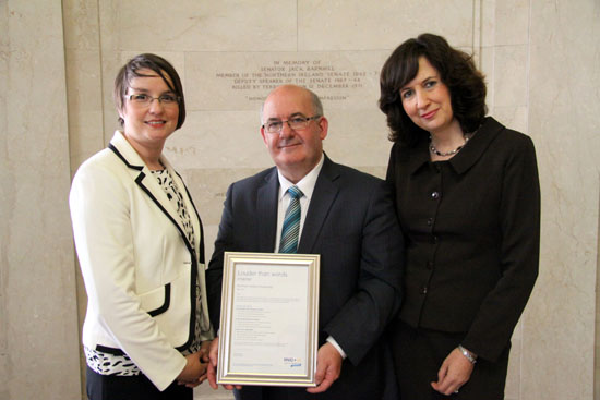 The Speaker of the Northern Ireland Assembly, William Hay MLA is presented with the RNID Action on Hearing Loss 'Louder than Words' best practice chartermark.