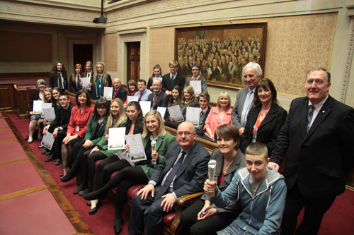 The Speaker of the Northern Ireland Assembly, Mr William Hay MLA, awarded prizes to winners of an Assembly competition to mark the 100th anniversary of women's suffrage.  Pictured with the Speaker (front row, third from right) are MLAs, teachers and competition winners