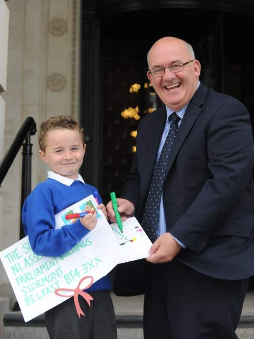 The Speaker of the Northern Ireland Assembly, William Hay MLA, is calling on budding young artists at Key Stage 2 in primary schools across Northern Ireland to design this year's official Assembly Christmas Card. Helping the Speaker to launch this exciting new competition is James Murphy from St Joseph's Primary School in East Belfast.